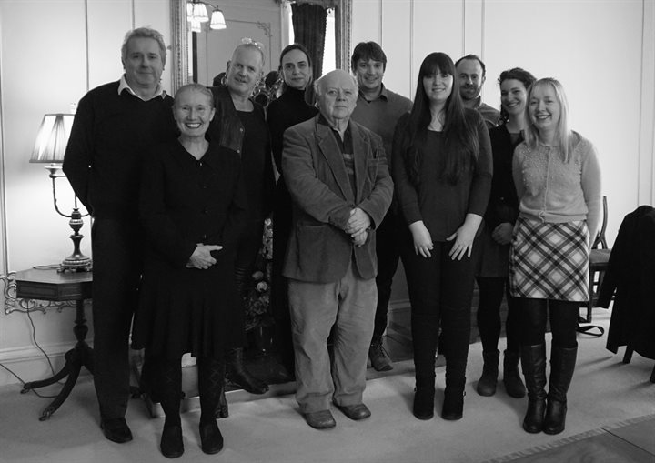 black and white photograph of the team and steering committee members. Ten people stood in a group and smiling at the camera!