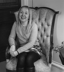 black and white photo of Hayley Cotterill, seated.