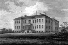 Black and white image of Derbyshire General Infirmary as it looked in 1819, Georgian-style symmetrical building with white exterior, three floors of windows.