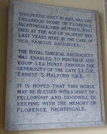 Lea Hurst entrance hall plaque. The text reads: 'This house, built in 1820, was the childhood home of Florence Nightingale. Her mother, who died at the age of 94, spent her last years here in the care of her famous daughter. The Royal Surgical Aid Society was enabled to purchase and equip Lea Hurst through the generosity of the late Lt. Col. Ernest S. Halford O.B.E. It is hoped that this house may be blessed with a spirit of fellowship and goodwill, in keeping with the memory of Florence Nightingale.'