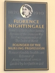 Plaque to Nightingale in Derby cathedral, featuring her dates and referring to her as the Founder of the Nursing Profession, pioneer of public health care, Reformer of Army medical services, guided by her faith in God.